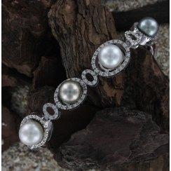 Pulsera de oro blanco con diamantes y perlas